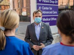 Rep. Quigley speaks with two nurses outside a hospital conducting COVID-19 testing