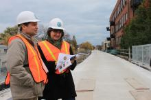 Rep. Quigley tours the 606 Trail and reviews renderings with Beth White, Chicago Office Director for The Trust for Public Land.