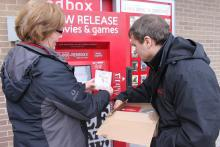 Rep. Quigley learned how to fully service a Redbox machine from Redbox Field Merchandiser Barb Conrath.
