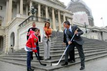 Rep. Quigley (left) and Rep. Jolly (right) face off on the Capitol steps as House Minority Leader Nancy Pelosi drops the puck.