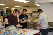Rep. Quigley Preparing Meals with MOW Volunteers