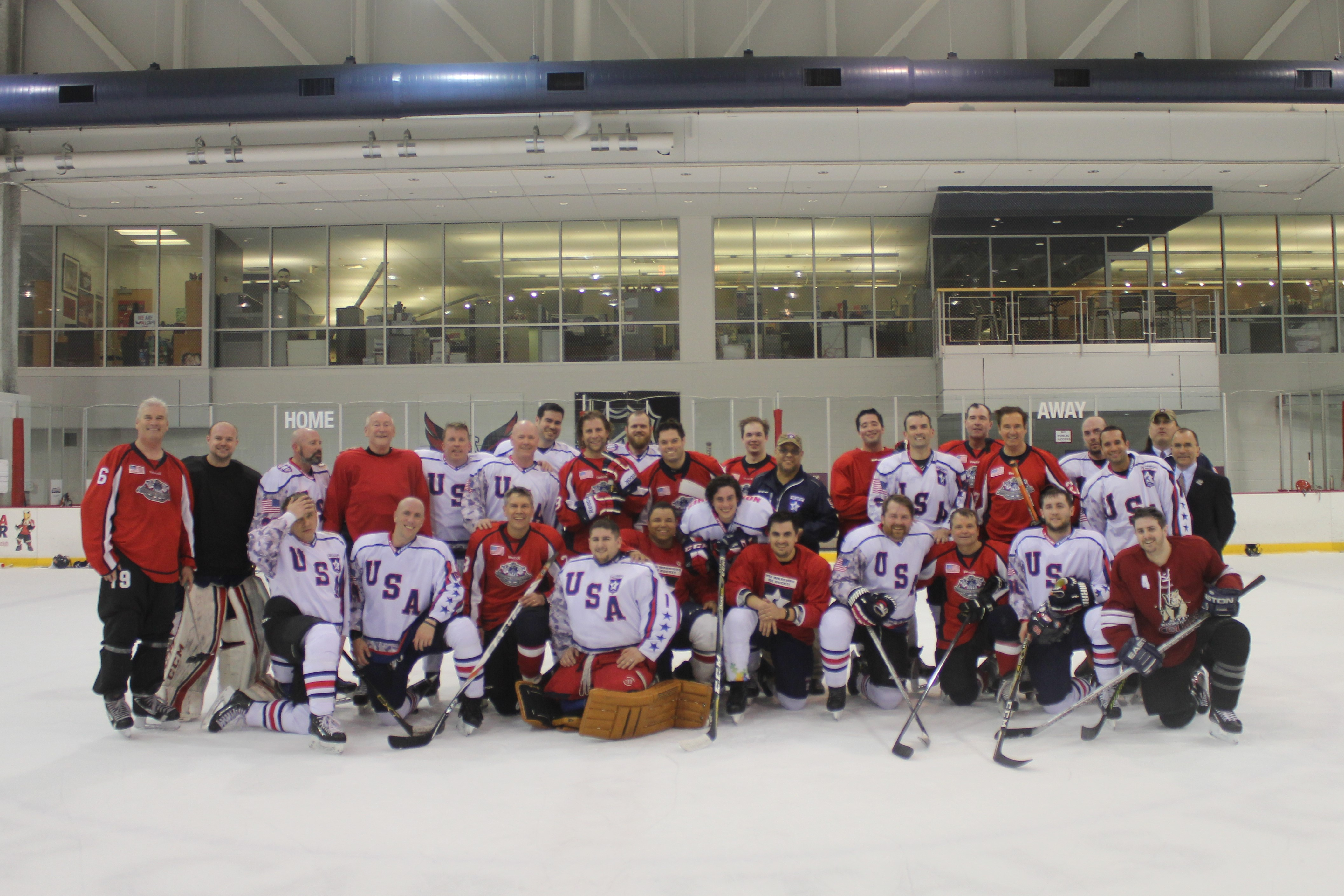 Rep. Mike Quigley poses with the USA Warriors hockey team after a match.